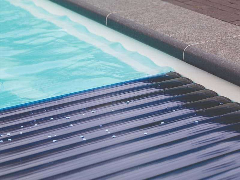 close up of automatic slatted pool cover