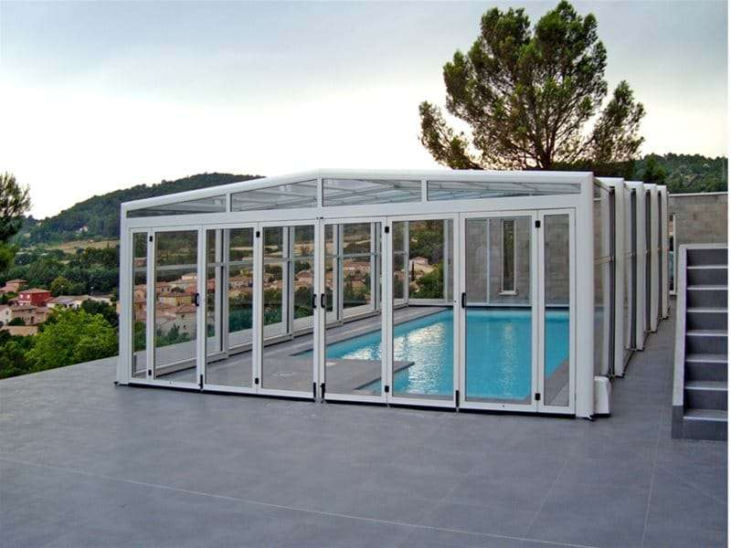 orion pool enclosure covering a one piece swimming pool.
