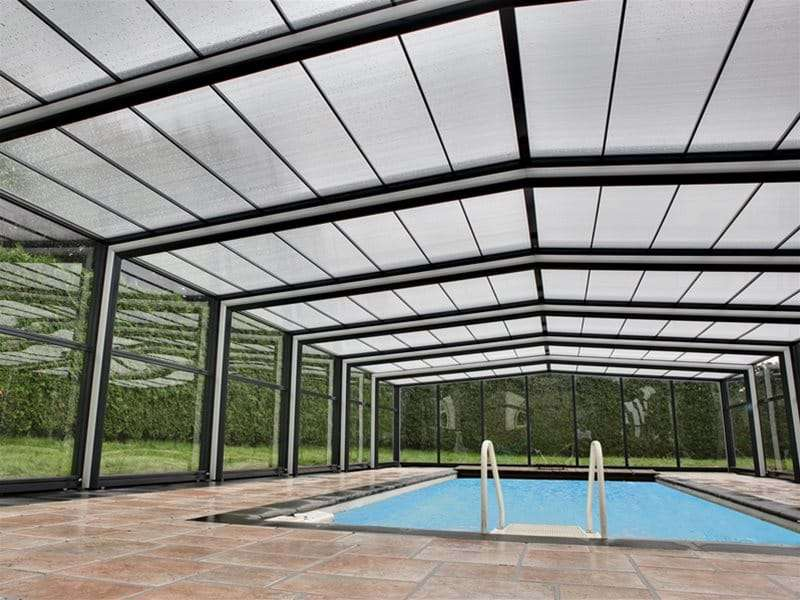 inside view of orion pool enclosure covering a one piece swimming pool.