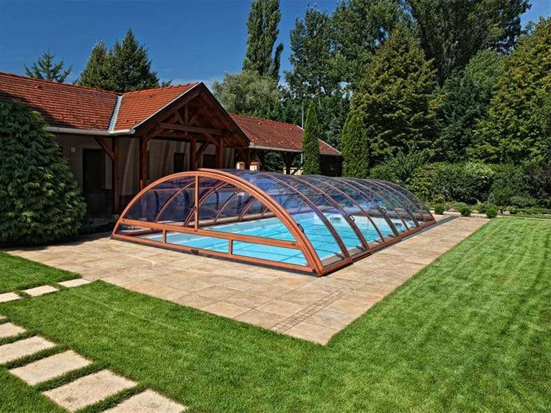 sun or sky pool enclosure covering a one piece swimming pool.