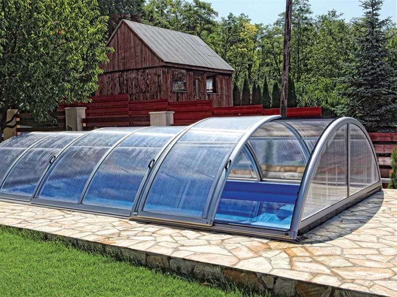 sun or sky pool enclosure with one section retracted.