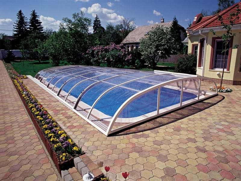 star or star plus pool enclosure covering a one piece swimming pool.