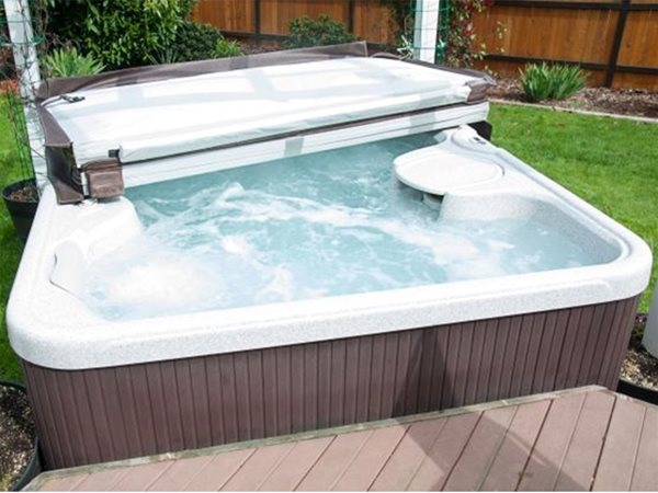 automatic slatted pool cover, half open.