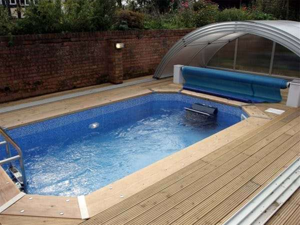 one piece swimming pool with fastlane swimming machine.