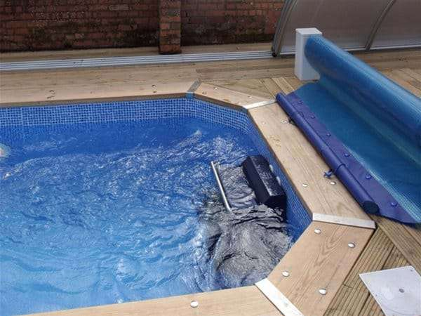 fastlane swimming machine installed at end of one piece swimming pool.