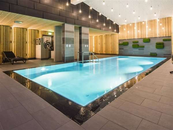 Indoor Overflow Multi one piece swimming pool.