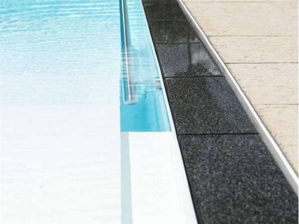 close up of overflow multi one piece swimming pool.
