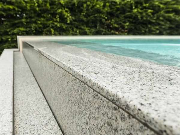 close up of overflow infinity one piece swimming pool.