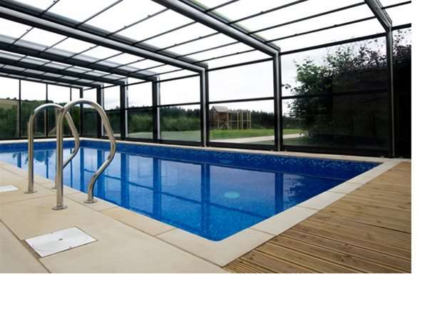 lean to telescopic enclosure over outdoor swimming pool.