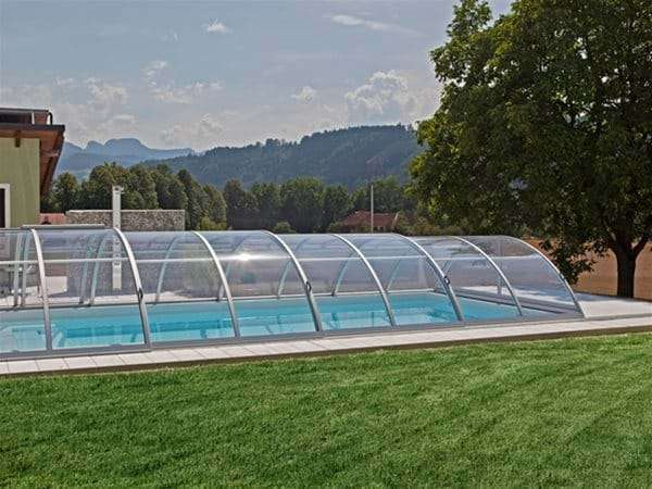 one piece swimming pool with sun or sky pool enclosure.