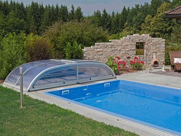 one piece swimming pool with star or star plus pool enclosure retracted