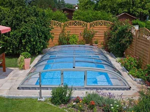 one piece swimming pool with AQBox pool enclosure.